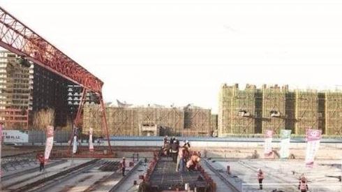 火炬路跨线桥:吹起冲刺号角 建成跨铁长龙
